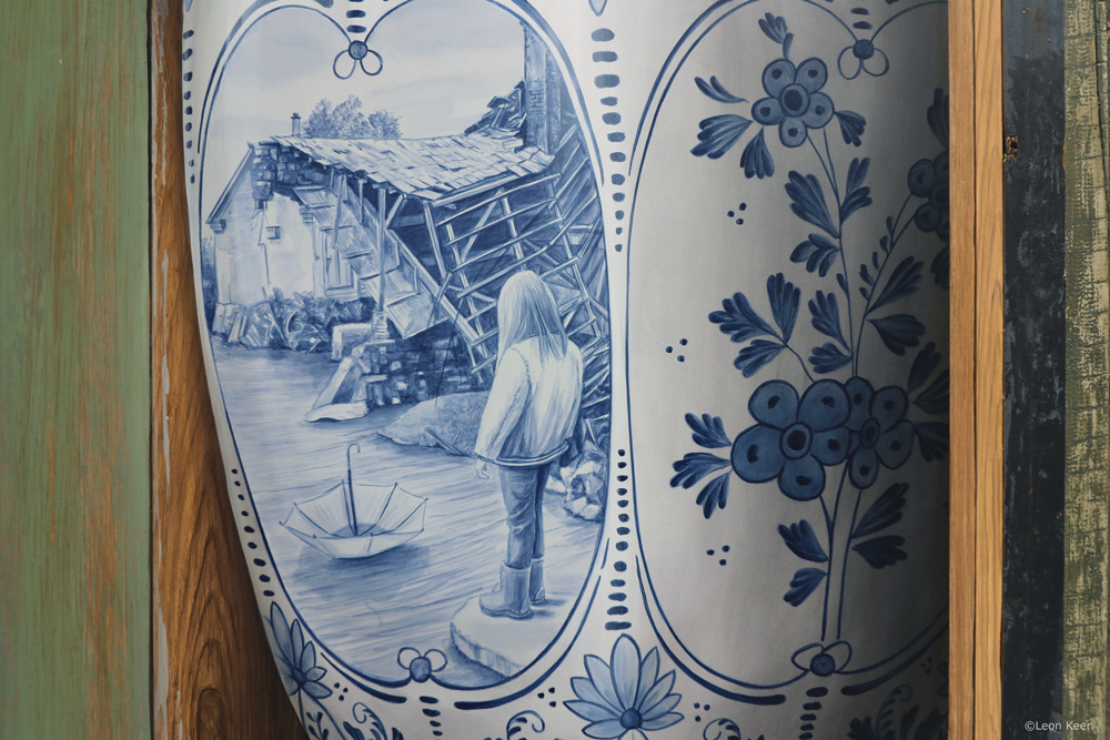Art by Leon Keer Despair flood delft blue vase