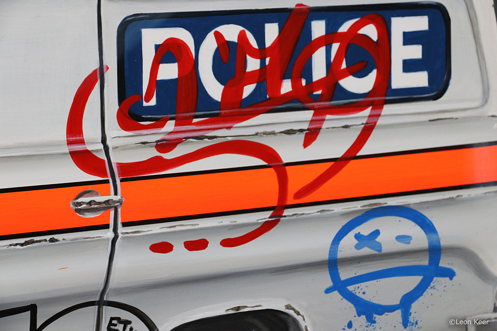 Tagged Police Car by Leon Keer
