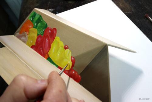 Opioid-illusion-by-leonkeer-art-gummybears-cardbordbox